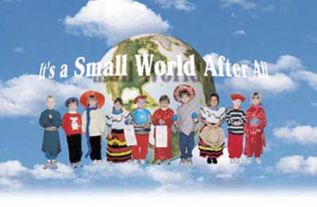 children dressed in their countries style of dress standing in front of a globe symbolizing that it is a small world afterall